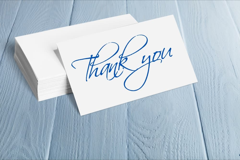 Thank you note in blue written in cursive