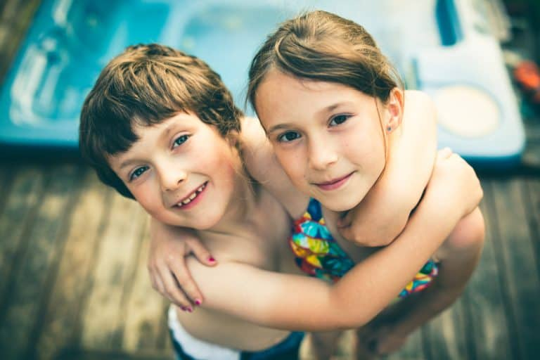Young Brother and sister hugging each other