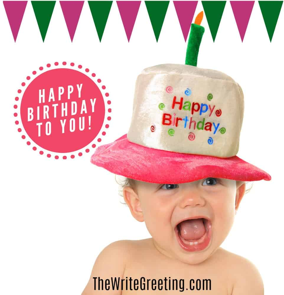 a little boy with a happy birthday on his head and a green and red banner above his head