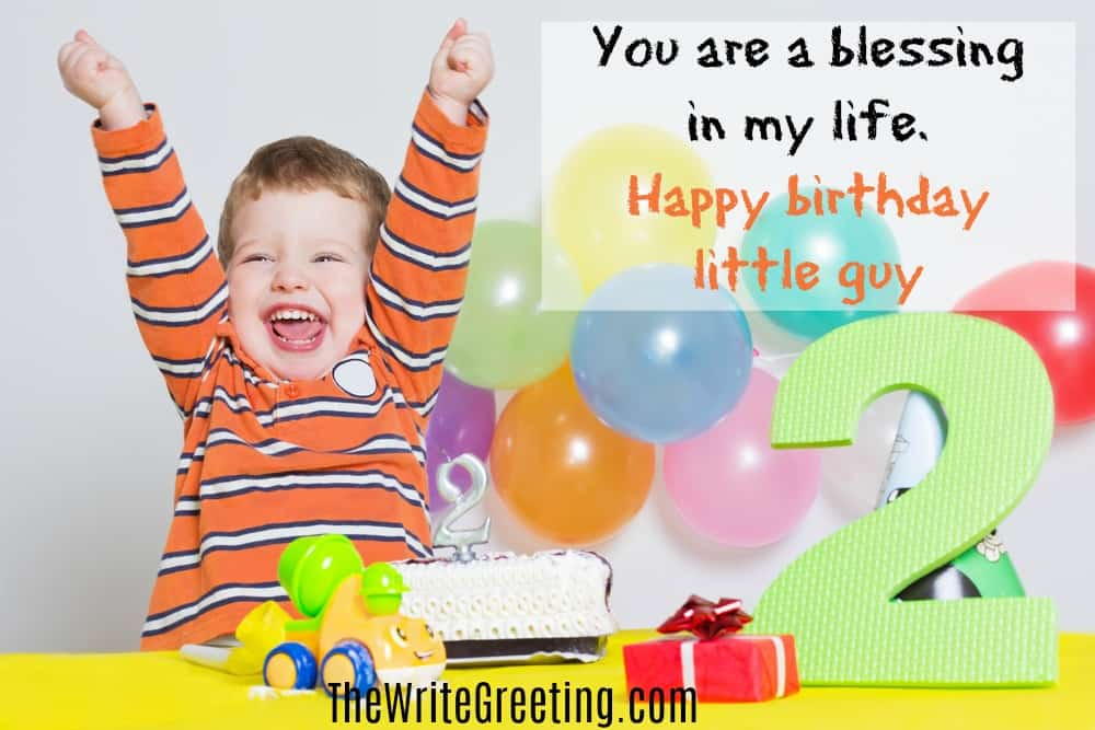 A toddler boy with a happy birthday sign surrounded by balloons