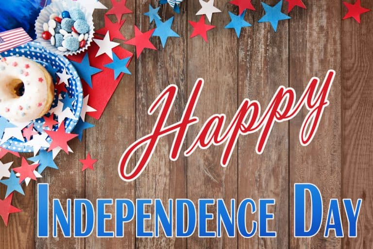 Happy independence day sign in blue and red with donuts and berries in the background