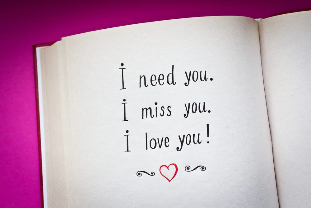 love messages written on a notebook with pink background