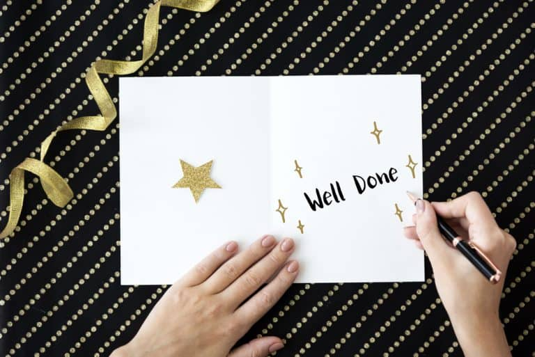 the words well done written in white card