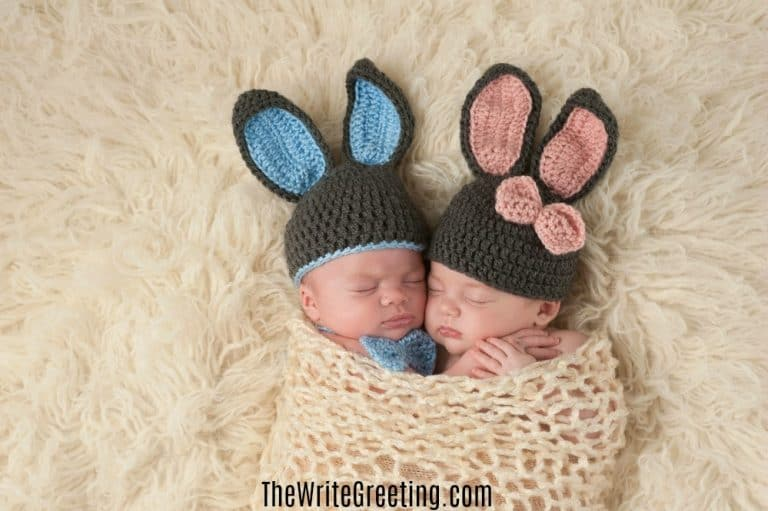 Sleeping newborn twins wearing bunny hats and swaddled together