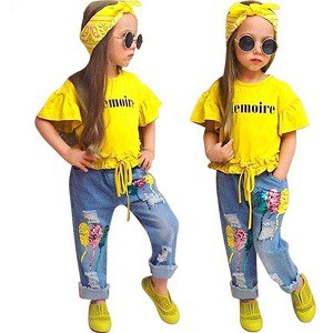 girl twins wearing a yellow and jeans outfit