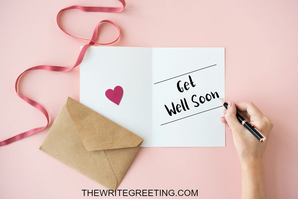Get well soon being written on a notecard