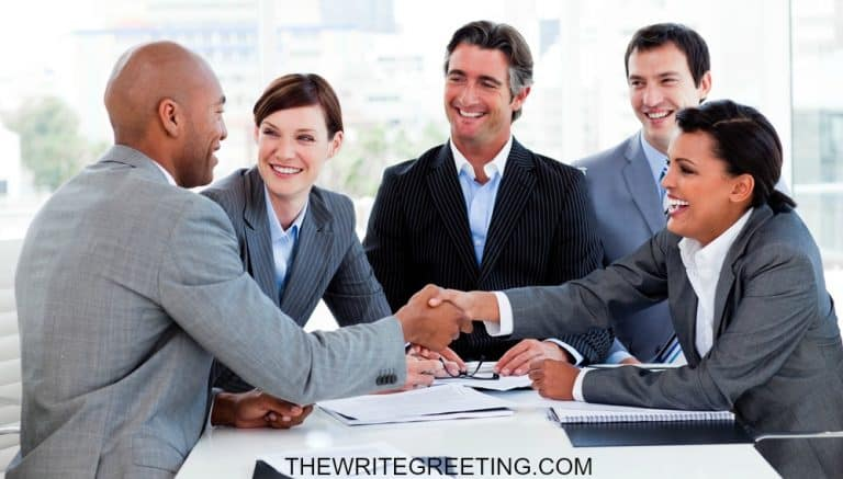 Colleagues congratulating african american man on job promotion