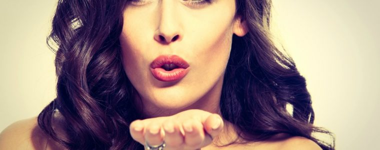 a sexy woman blowing a kiss