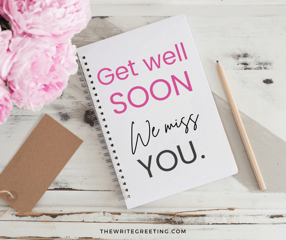 get well soon text written in pink on a notebook