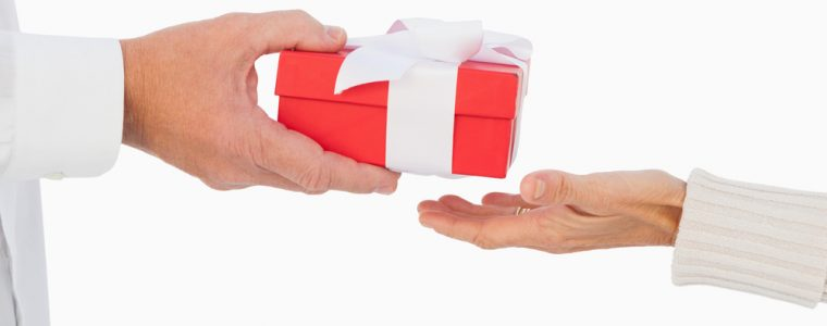 older hands passing a retirement gift.