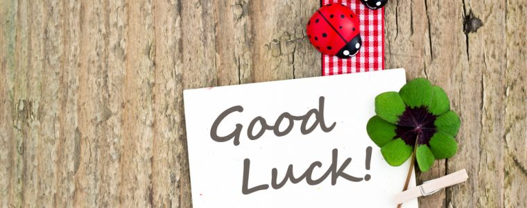 good luck text written on white note with ladybird