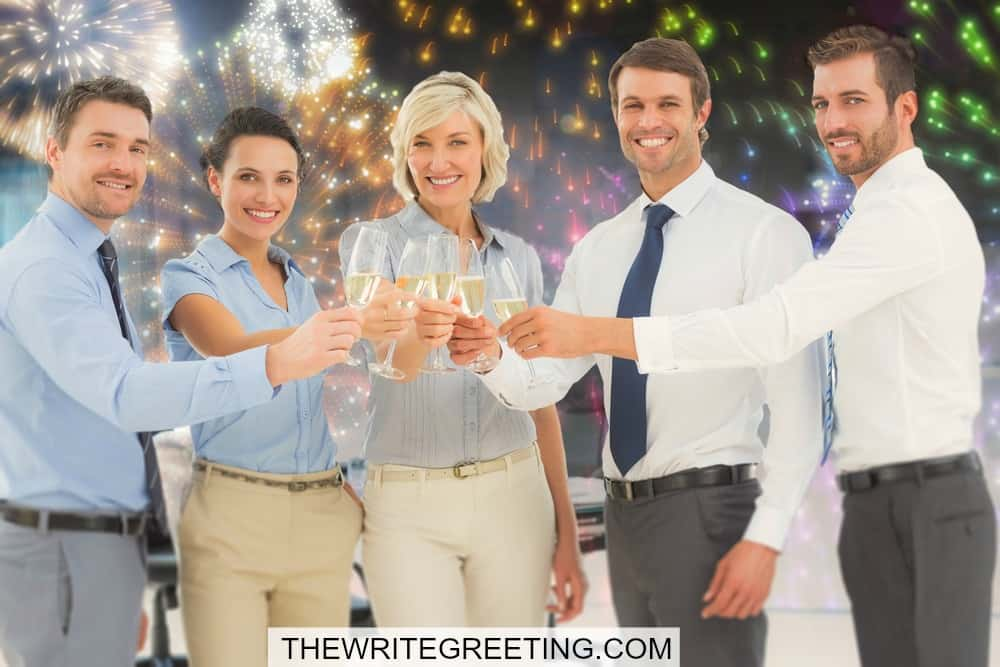 Business professionals celebrating with champagne