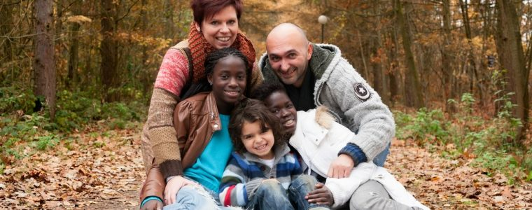 Multi racial foster family in park
