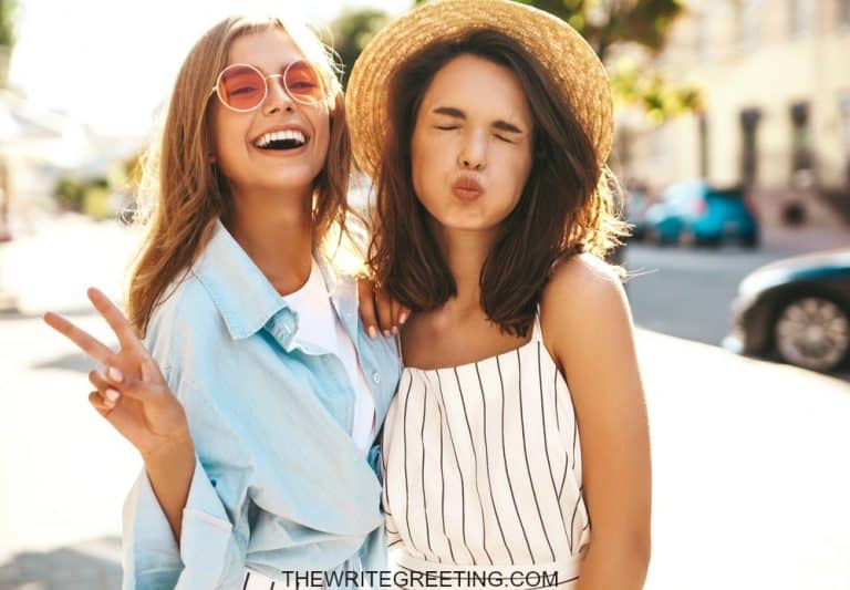2 young girls laughing and goofing off
