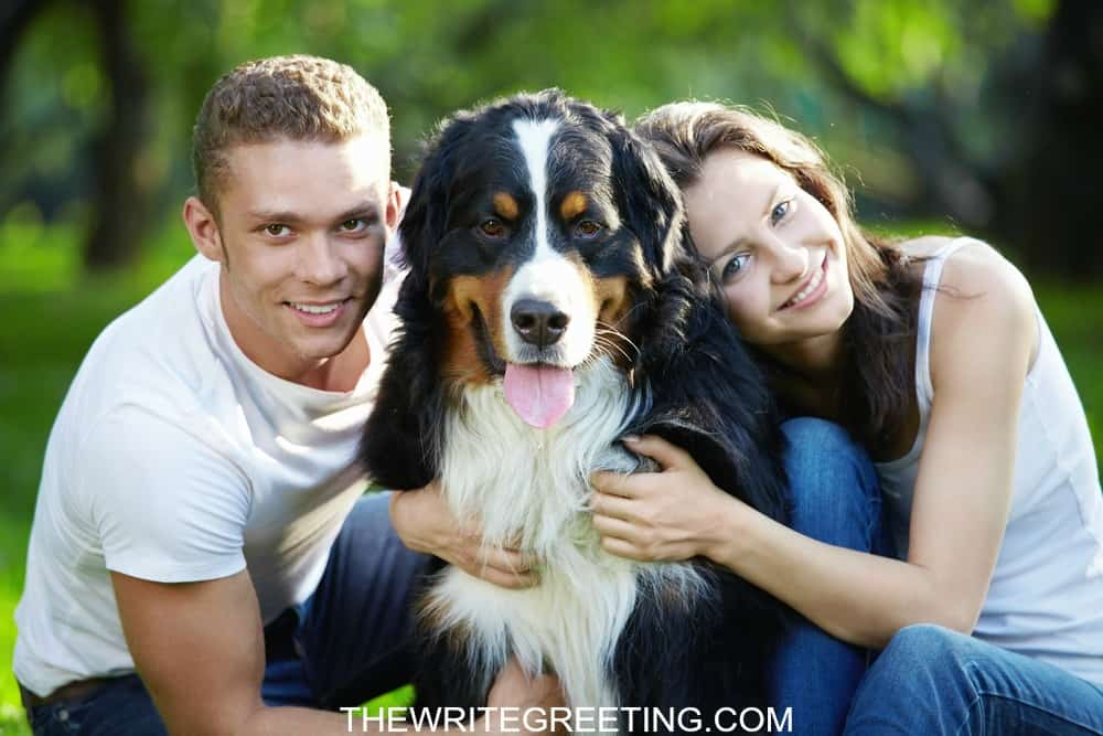 A young couple loving on their dog