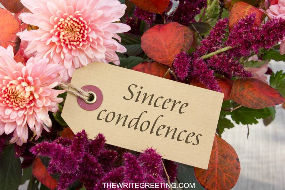 Text sincere condolences beside pink flowers
