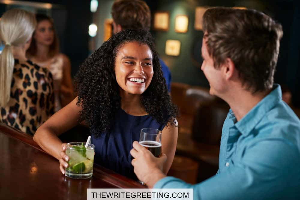 Young couple having drinks at a bar