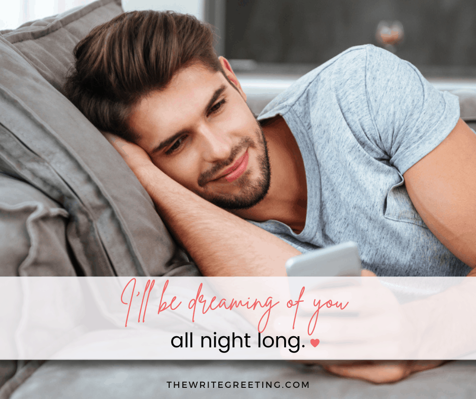 Man reading text from long distance girlfriend in bed