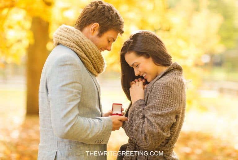 Couple getting engaged in the forest