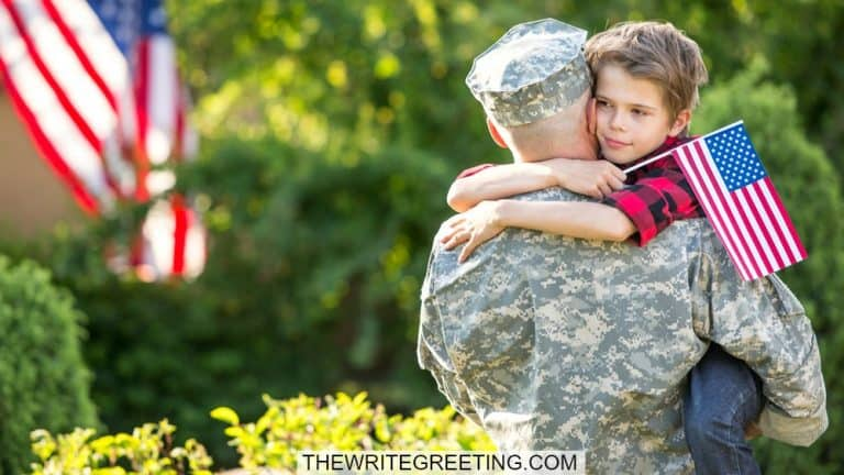 Young boy hugging military dad