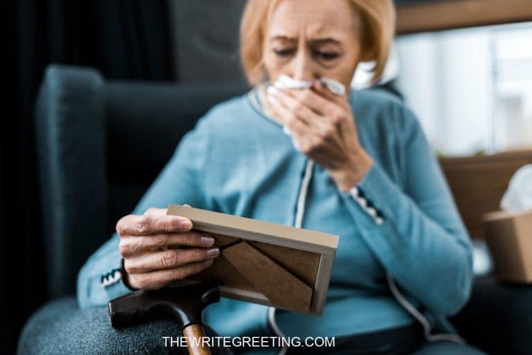 Woman crying over picture of loved one