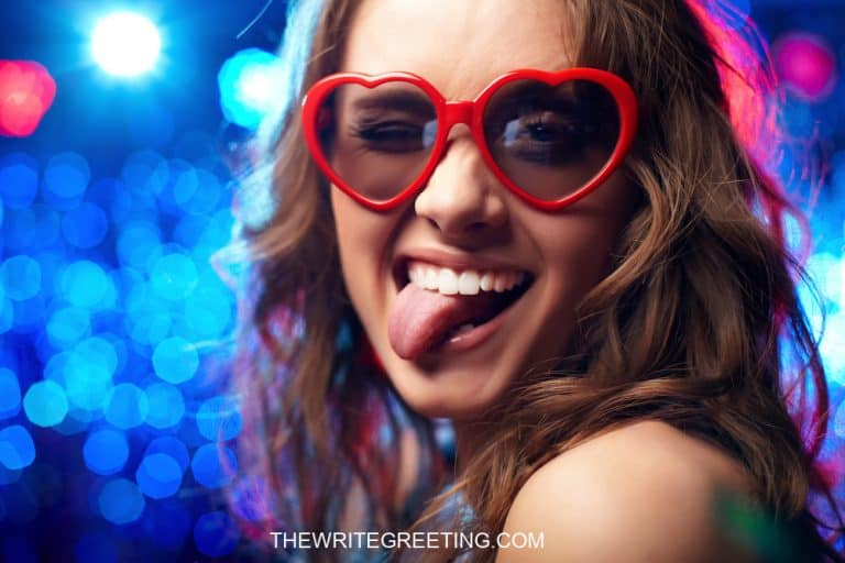 Female wearing valentine glasses smiling
