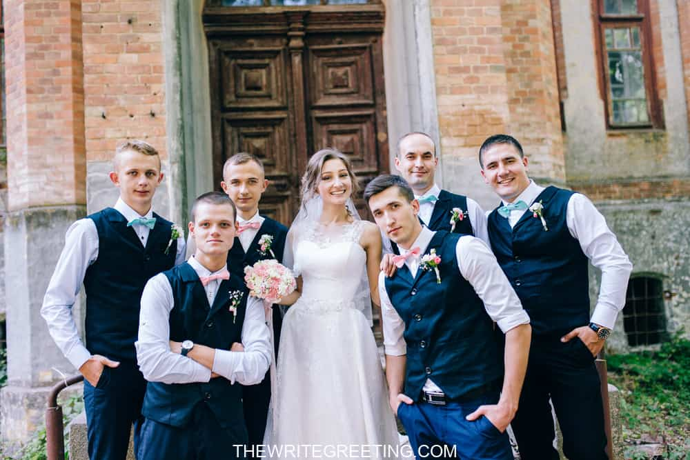 Bridge surrounded by groomsmen