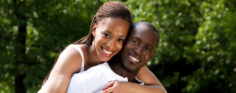 smiling young African American couple in love