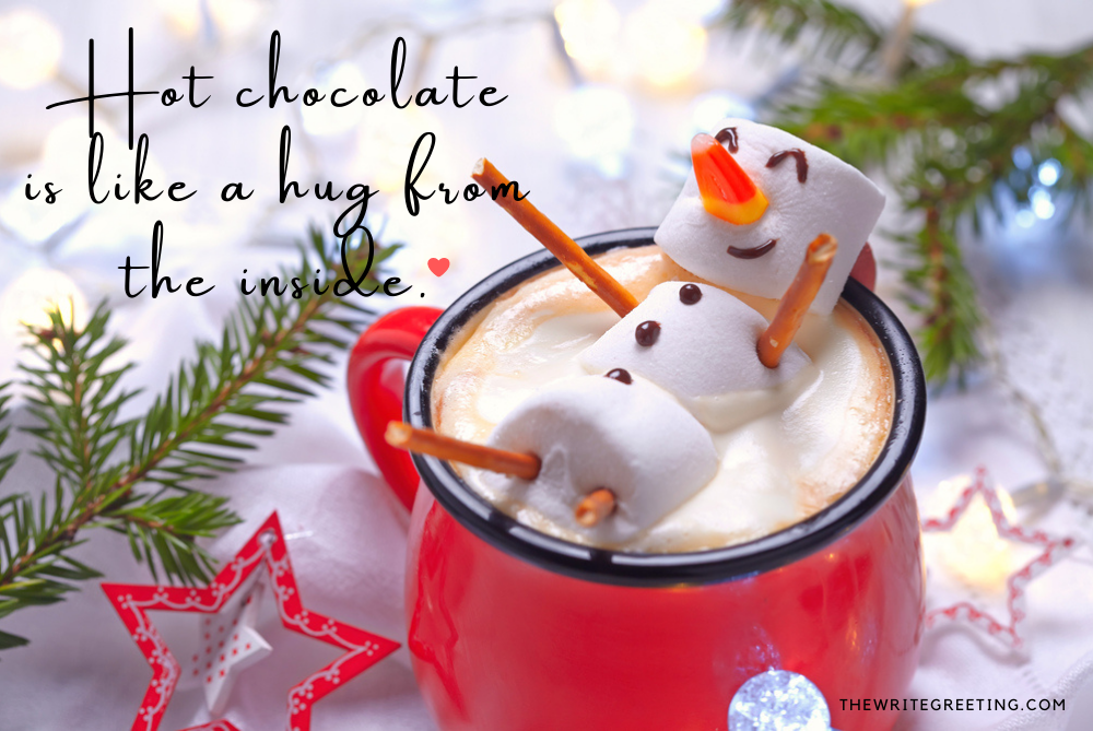 Marshmallow snowman sitting in hot cocoa