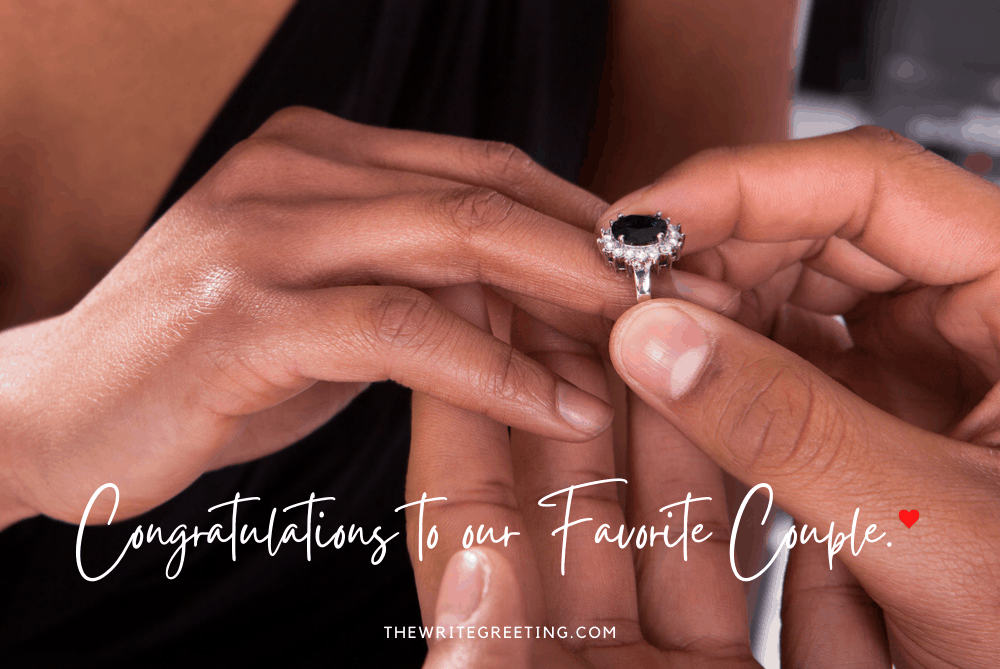 African American couple with engagement ring