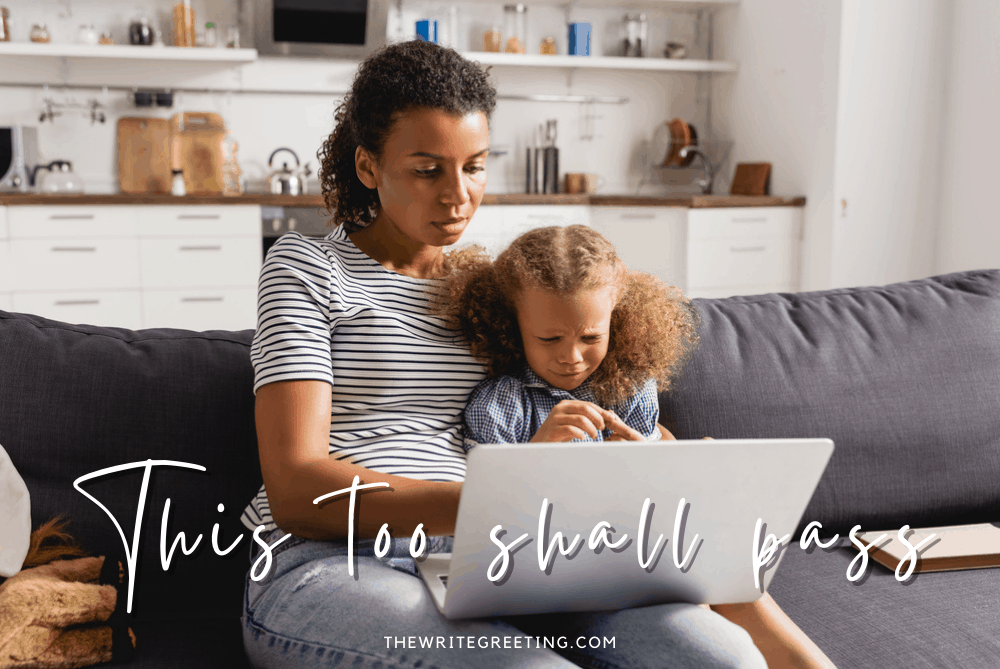 African American mom holding computer and unhappy toddler daughter