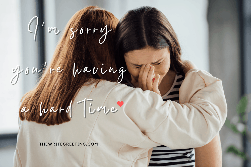 2 young women supporting each other with hugs