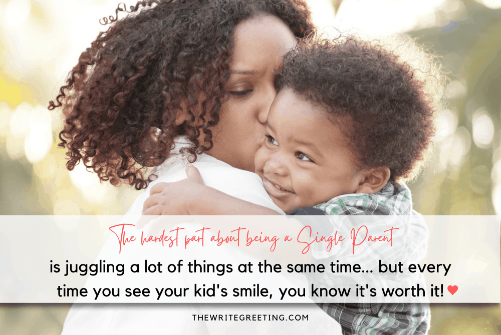 African American single mom kissing toddler son